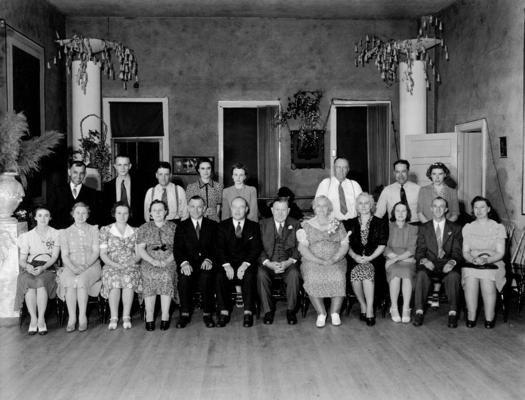 Henry and Appolonia's 50th wedding anniversary, picture 2, which includes: Back row, left to right: Rudolph Pittler, Albert Drews, Gregor Meyer, Elsie (Krueger) Bingen, Annabelle (Waller) Bingen, Alvin Carpenter, George Borieo, Marceline (Eserhut) Bingen. <br>Front row, left to right: Adeline Bingen-Smithy (her husband ran off on her prior to this anniversary and she kept her married name until he was legally declared dead and ended up remarrying), Oliva Bingen-Pittler, Crescenta Bingen--Drews, Josephine Bingen-Meyer, Alfred