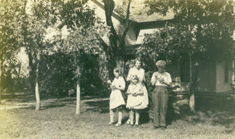 Dorothy and Delores Bingen in front, with Pearl and Ken Bingen in back. On the farm in Groton, SD.