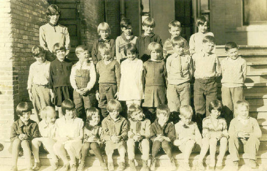 Kenneth Bingen(at far left in the middle row) & his 5th grade class